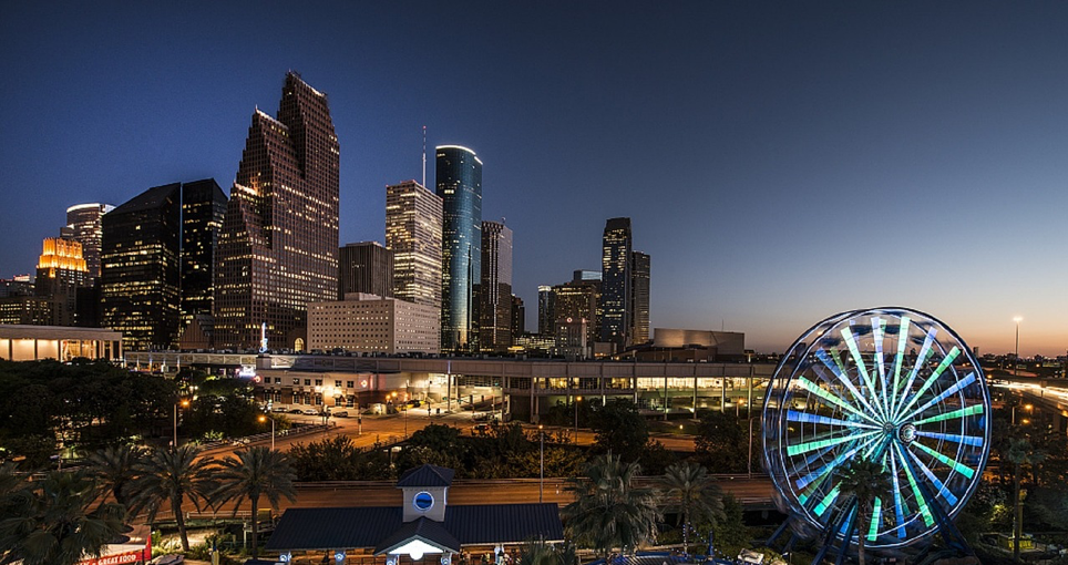 Image of conference             location, Houston skyline at dusk
